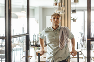 Young man working in his start-up cafe, portrait - GUSF01241