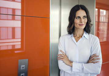 Portrait of a successful businesswoman, with arms crossed - KNSF04476