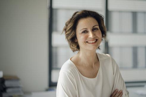 Portrait of a successful businesswoman in her office - KNSF04542