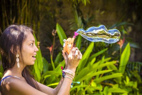 Young Asian womans blowing bubbles. - AURF02190