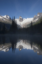 Rock spires and glaciers reflected in an alpine pond. - AURF02304
