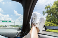 Italy, feet of woman leaning out of car window - JUNF01139