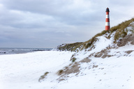 Germany, Schleswig-Holstein, Sylt, beach, dune and lighthouse in winter - KLRF00691