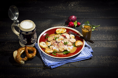 Bavarian veal sausage salad with roasted pretzel rolls, sweet mustard, pretzels, red radish and beer mug - MAEF12723