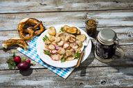 Bavarian veal sausage salad with roasted pretzel rolls, sweet mustard, pretzels, red radish and beer mug - MAEF12726
