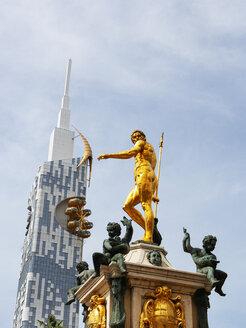 Georgia, Adjara, Batumi, Golden sculpture on the Neptune fountain with technical university in background - WWF04370