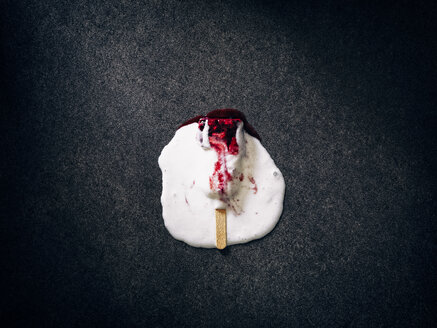 Melting homemade ice cream with berries on dark ground - RAMAF00080