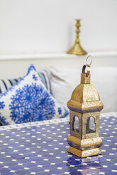 Morocco, golden latern on table - MMAF00538
