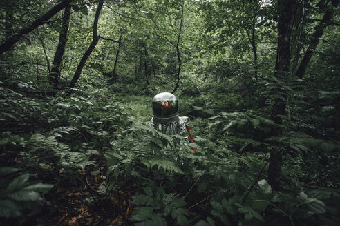 Spaceman exploring nature, looking at forest - VPIF00539