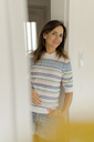 Portrait of smiling mature woman at home - KNSF04762