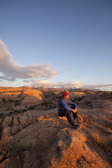 Young man hiking on slickrock near Moab, Utah. - AURF02869