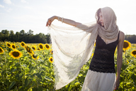 Woman poses for portrait on summer day - AURF02881