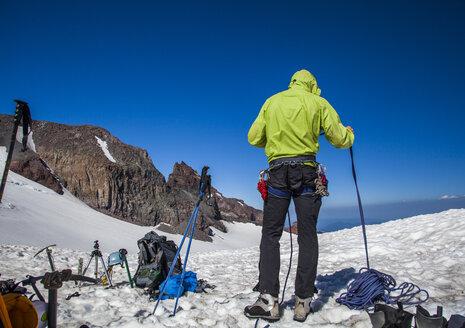 A climber gets organized at Camp Muir while climbing Mount Rainier in Mount Rainier National Park, Washington, USA. - AURF02905