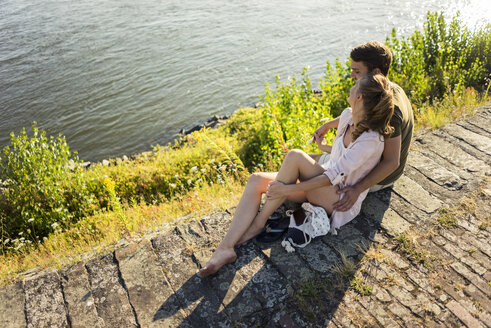 Happy couple relaxing at the riverside in summer - JOSF02571