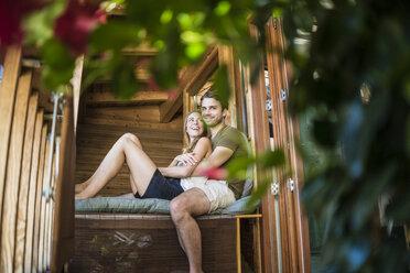 Happy couple relaxing on balcony - JOSF02640