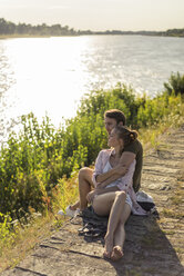 Couple relaxing at the riverside in summer - JOSF02661