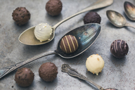 Various chocolate truffles and old spoons - JUNF01164