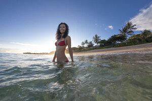 Young Woman Enjoying The Clear Tropical Water Of Oahu, Hawaii - AURF03275