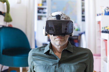 Portrait of mature man at home using Virtual Reality Glasses - TCF05818