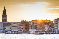 Italy, Venice, view from the lagoon towards St Mark's Square with Campanile at sunset - JUNF01198
