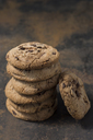 Stack of chocolate cookies on rusty metal - JUNF01244