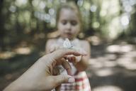 Butterfly on woman's finger - KMKF00462