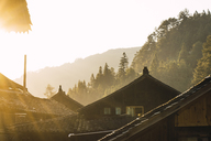 China, Guizhou, houses of a Miao settlement in backlight - KKAF01637