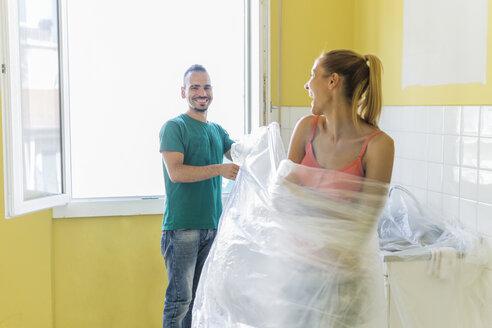 Couple renovating new home having fun - FBAF00026