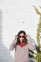 Portrait of fashionable woman  wearing red sunglasses - IGGF00525