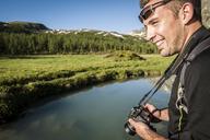 Outdoor photographer enjoys the great environment of Devero National Park. Ossola, Italy. - AURF03500