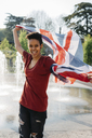 Portrait of happy young woman with Union Jack - GIOF04274