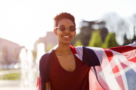 Portrait of smiling young woman with Union Jack - GIOF04277