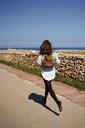 Young brunette woman running outdoor - IGGF00537
