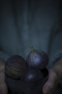Woman's hands holding bowl of figs - JES00150