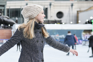 Young blonde woman ice skating - IGGF00553