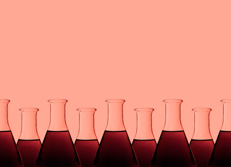 Row of test tubes with liquid, red background - DRBF00097
