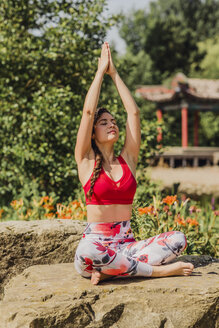 Young woman practicing Pilates in an urban park - NMSF00221