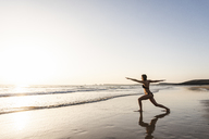Young woman practicing yoga on the beach - UUF15141