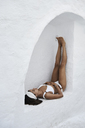 Young woman wearing white bikini having a rest in a wall niche - IGGF00579