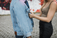 Mid-section of affectionate young couple outdoors - MAUF01718