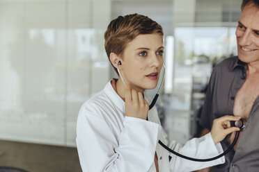 Female doctor examining patient with a stethoscope - MFF04491