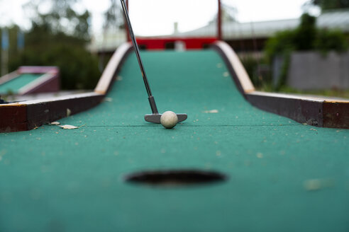 Ball and club playing miniature golf - KKAF01737