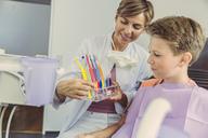 Dentist examining boy's teeth with dental instruments - MFF04536