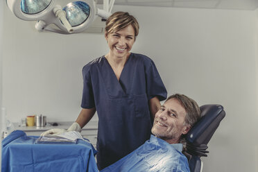 Dental surgeon talking to patient before treatment - MFF04569