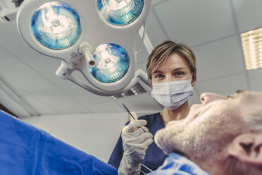 Dental surgeon during surgical procedure on a patient - MFF04572