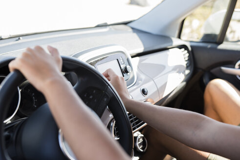 Hands on a steering wheel, driving a car - PACF00098