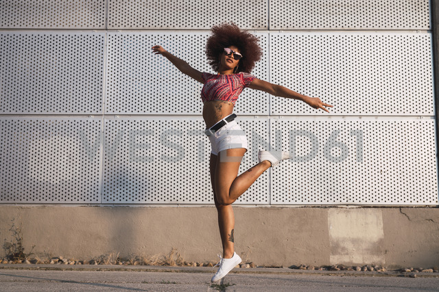 Portrait of fashionable woman jumping in the air - KKAF01753