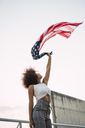 Young woman swinging American flag - KKAF01768