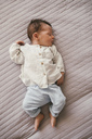 Newborn baby boy sleeping on a blanket - MFF04621