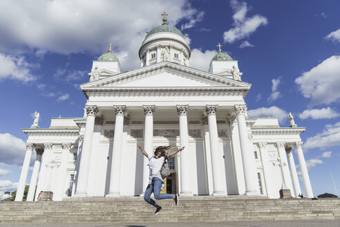 Finland, Helsinki, woman jumping in front of Helsinki Cathedral - KKAF01781